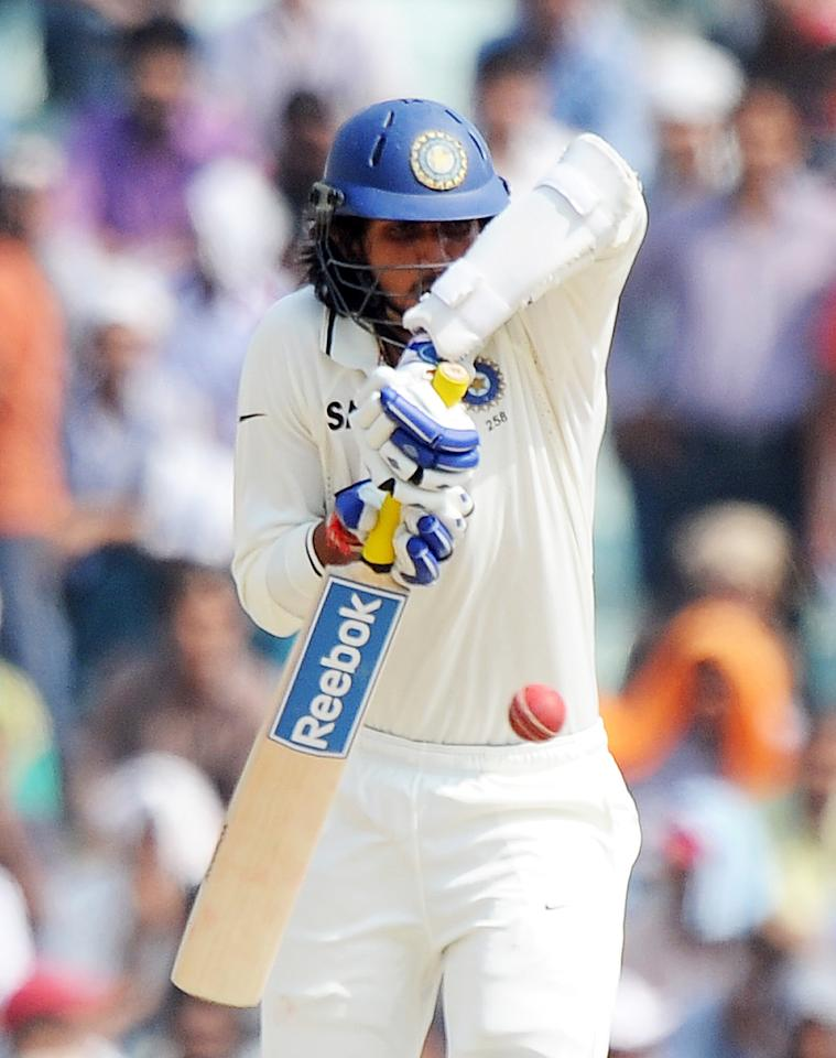 Indian cricketer Ishant Sharma plays a shot during the final day of the first Test between India and Australia in Mohali on October 5, 2010.  Fast bowler Doug Bollinger grabbed two wickets to keep alive Australia's hopes of winning the opening Test against India.     AFP PHOTO/Dibyangshu SARKAR (Photo credit should read DIBYANGSHU SARKAR/AFP/Getty Images)
