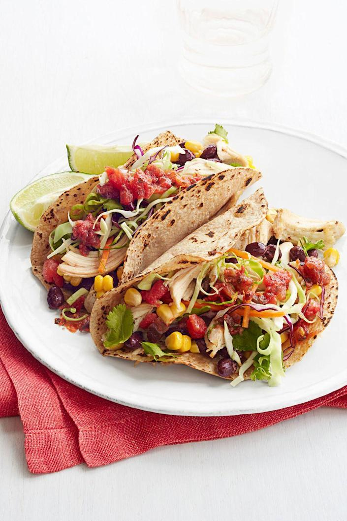 """<p>This homemade version of the takeout fave is <em>way </em>healthier, thanks to whole-grain tortillas, colorful veggies and no-salt-added black beans.</p><p><em><a href=""""https://www.goodhousekeeping.com/food-recipes/a14538/super-speedy-chicken-tacos-recipe-ghk0214/"""" rel=""""nofollow noopener"""" target=""""_blank"""" data-ylk=""""slk:Get the recipe for Super-Speedy Chicken Tacos »"""" class=""""link rapid-noclick-resp"""">Get the recipe for Super-Speedy Chicken Tacos »</a></em> </p>"""