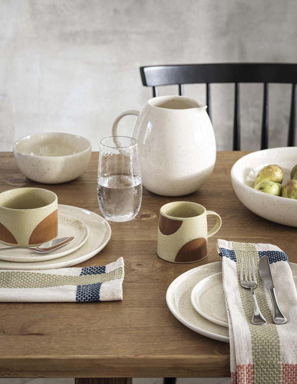 <p>'The tableware, which is all handmade in Portugal using traditional manufacturing techniques, draws inspiration from tactile, organic forms,' adds David Hutcheson, Senior Homewares Designer</p><p>'Glazed with a speckled reactive finish, each piece is completely unique and individual.'</p><p>With mugs for just £3 and gorgeous linen napkins, there's no excuse not to add some to your kitchen cupboards. </p>
