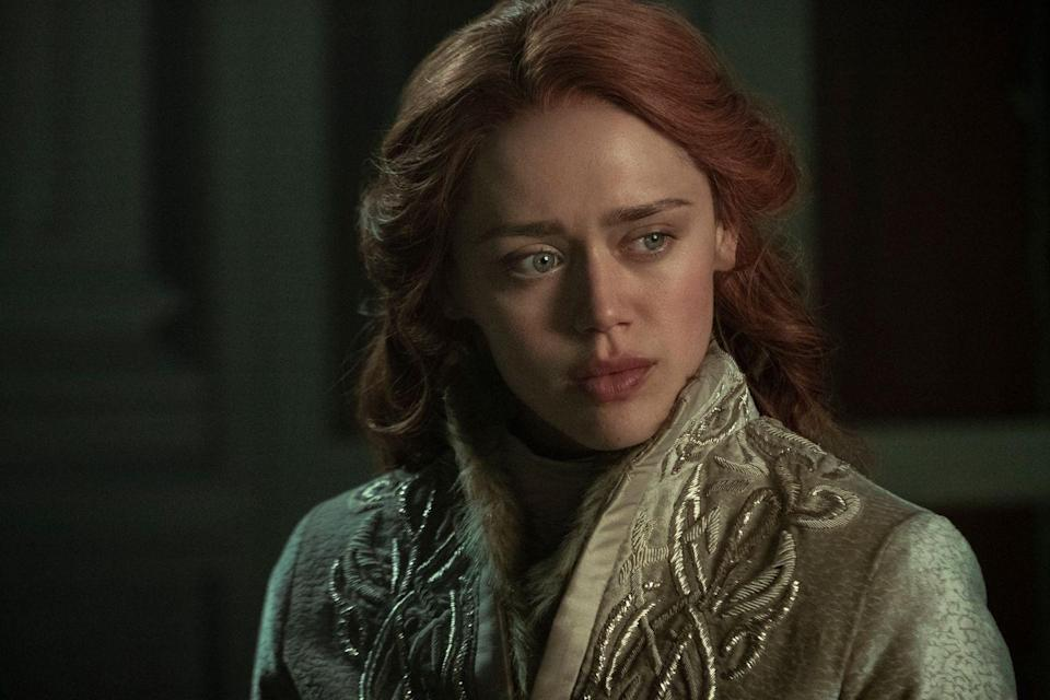 <p>Genya is a Tailor at the royal palace in Ravka, where she's lived since she was five. When Alina arrives, Genya dresses her and gets her ready to meet the king of Ravka. They also become confidants.</p><p>Head is an English actress who has appeared in the shows <em>Harlots</em>, <em>The Syndicate</em>, and <em>Girlfriends</em> (a 2018 British series, not the one staring Tracie Ellis-Ross). She also appeared in the 2016 film <em>Underworld: Blood Wars</em>.</p>