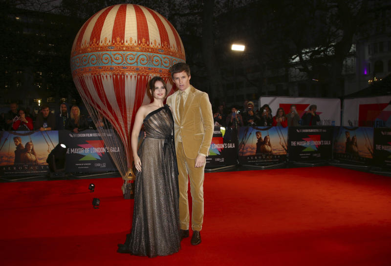 Actors Felicity Jones, left, and Eddie Redmayne pose for photographers upon arrival at the premiere of the film 'The Aeronauts' which is screened as part of the London Film Festival, in central London, Monday, Oct. 7, 2019. (Photo by Joel C Ryan/Invision/AP)