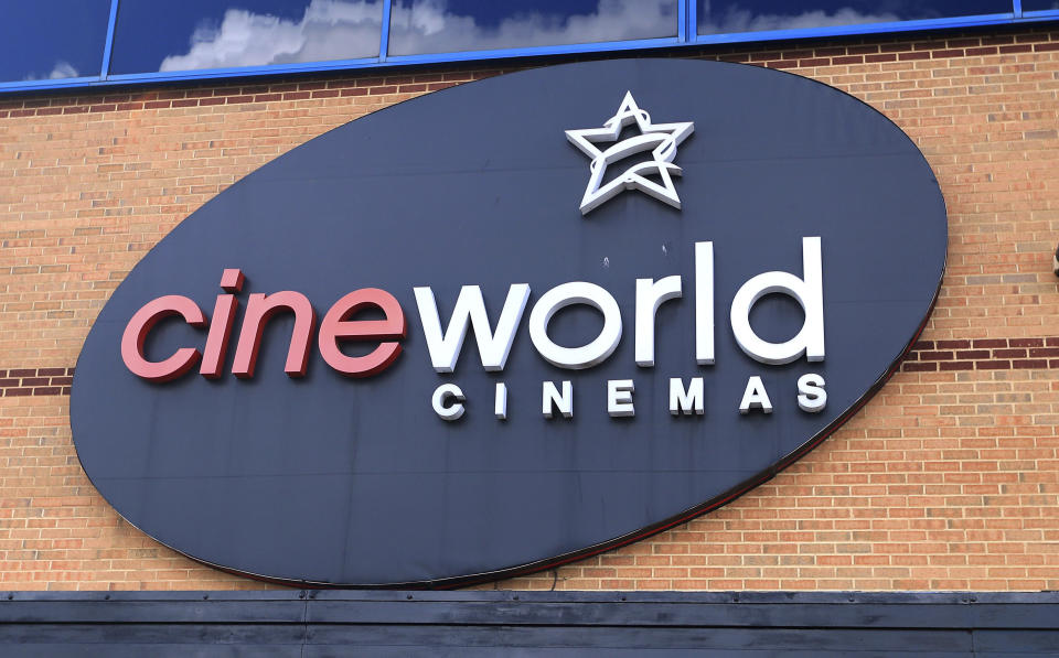 FILE - This June 18, 2020 file photo shows the logo of a Cineworld cinema in Northampton, England. U.K. media say cinema chain Cineworld will close all its U.K. venues after the postponement of the new James Bond film left a big hole in theaters' schedules. The Sunday Times reported on Sunday, Oct, 4 that Cineworld's 128 theaters in the U.K. and Ireland will shut in the coming weeks, putting up to 5,500 people out of work. (Mike Egerton/PA via AP, file)