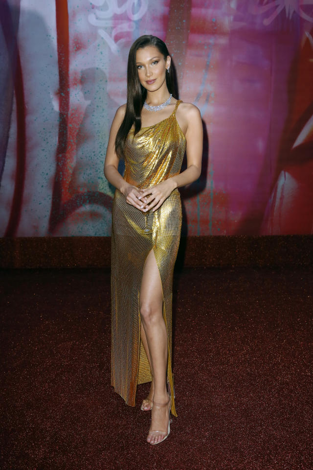 <p>Bella Hadid deserves all the fire emojis for her latest look, as the model chose a slinky Versace dress for the BVLGARI dinner and party on June 28. <em>[Photo: Getty]</em> </p>
