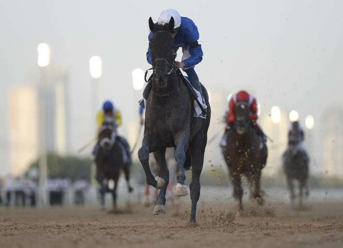 Rebel's Romance with jockey William Buick wins $750,000 Group 2 UAE Derby over 1900m (9.5 furlongs) in Dubai, the United Arab Emirates, Saturday, March 27, 2021. (AP Photo/Martin Dokoupil)