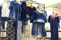 In this image from video, several clothes dyed by members of indigo dye group Japan Blue are displayed at a community center where residents evacuated when the 2011 earthquake hit the area in Minamisoma, Fukushima Prefecture, northeastern Japan, on Feb. 20, 2021. After the Fukushima nuclear plant disaster a decade ago, nearby farmers weren't allowed to grow crops for two years because of radiation. After the restriction was lifted, two farmers in the town of Minamisoma found an unusual way to rebuild their lives and help their destroyed community. Kiyoko Mori and Yoshiko Ogura planted indigo and soon began dying fabric with dye produced from the plants. (AP Photo/Chisato Tanaka)