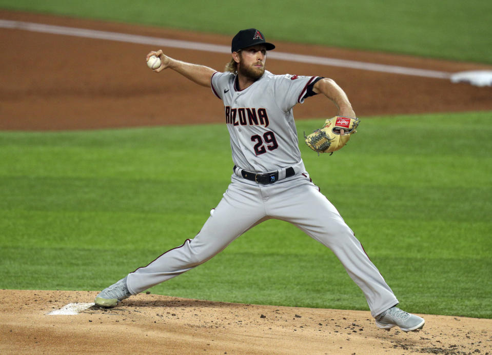 Arizona Diamondbacks starting pitcher Merrill Kelly (29) delivers a pitch against the Texas Rangers in the first inning of a baseball game Tuesday, July 28, 2020 in Arlington, Texas. (AP Photo/Richard W. Rodriguez)