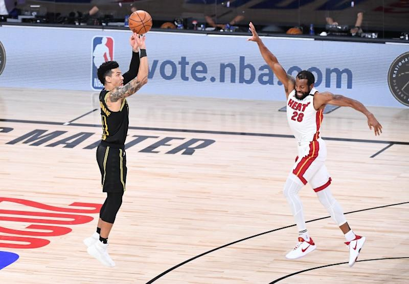 The Lakers' Danny Green misses a three-point try late in the game as the Heat's Andre Iguodala defends Oct. 9, 2020.