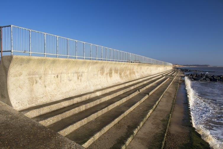 """<span class=""""caption"""">'Grey' sea defences cost a lot to build and maintain and the concrete they're often made from is a source of atmospheric carbon.</span> <span class=""""attribution""""><a class=""""link rapid-noclick-resp"""" href=""""https://www.shutterstock.com/image-photo/sea-wall-steps-southwold-suffolk-england-184771949?src=6BPQ1lAsnT4akY47RUxXgA-1-0"""" rel=""""nofollow noopener"""" target=""""_blank"""" data-ylk=""""slk:Sue Chillingworth/Shutterstock"""">Sue Chillingworth/Shutterstock</a></span>"""