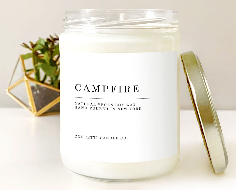 """<h3>Confetti Candle Co. Campfire Vegan Soy Candle</h3><br>This 4.7-star rated scent is hand-poured in Brooklyn, NY, and contains notes of blackberry wine, sweet tobacco, whiskey, cocoa and marshmallows, sandalwood, and cedar with hints of amber and patchouli.<br><br><strong>ConfettiCandleCo</strong> Campfire Vegan Candle Soy, $, available at <a href=""""https://go.skimresources.com/?id=30283X879131&url=https%3A%2F%2Fwww.etsy.com%2Flisting%2F783847840%2Fcampfire-vegan-candle-soy-natural-soy"""" rel=""""nofollow noopener"""" target=""""_blank"""" data-ylk=""""slk:Etsy"""" class=""""link rapid-noclick-resp"""">Etsy</a>"""