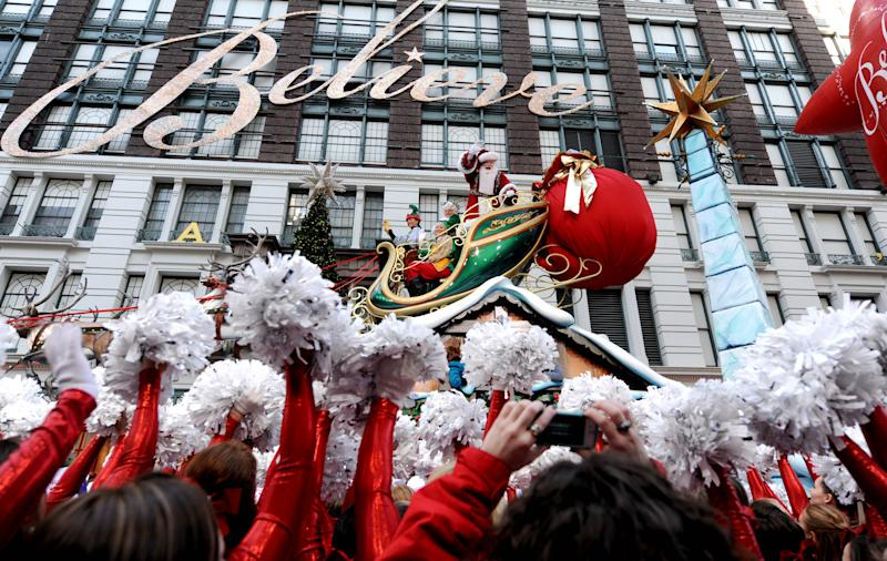 Santa Claus makes his way through Herald Square in the 86th annual Macy's Thanksgiving Day Parade,Thursday, Nov 22, 2012, in New York. The annual Macy's Thanksgiving Day Parade kicked off in New York on Thursday, putting a festive mood in the air in a city still coping with the aftermath of Superstorm Sandy. (AP Photo/ Louis Lanzano)