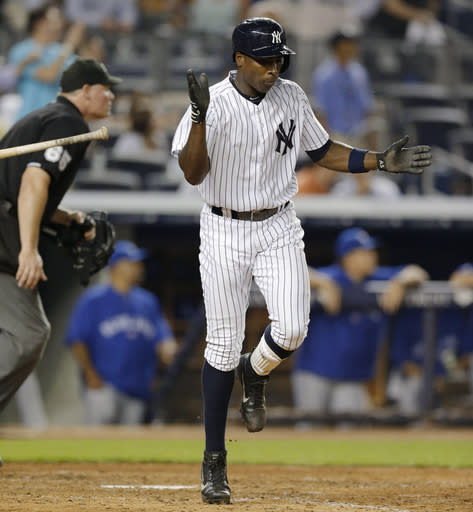 New York Yankees' Alfonso Soriano heads to first after hitting an eighth-inning, two-run home run off Toronto Blue Jays starting pitcher R.A. Dickey in a baseball game at Yankee Stadium, Wednesday, Aug. 21, 2013, in New York. The Yankees won 4-2. (AP Photo/Kathy Willens)