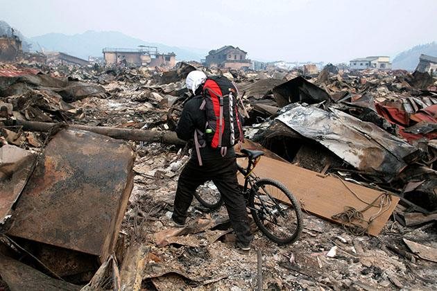 A young man walks through the devastation in Otsuchi, Japan. (Getty Images)