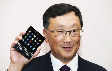 Chief Executive Officer of BlackBerry Ltd John Chen holds up the unreleased Blackberry Passport device at their annual general meeting for shareholders in Waterloo in this file photo taken June 19, 2014. BlackBerry is set to announce the acquisition of a German firm focused on voice and data encryption, burnishing its image in the eyes of ultra security conscious clients like government agencies. REUTERS/Mark Blinch/Files (CANADA - Tags: BUSINESS TELECOMS)