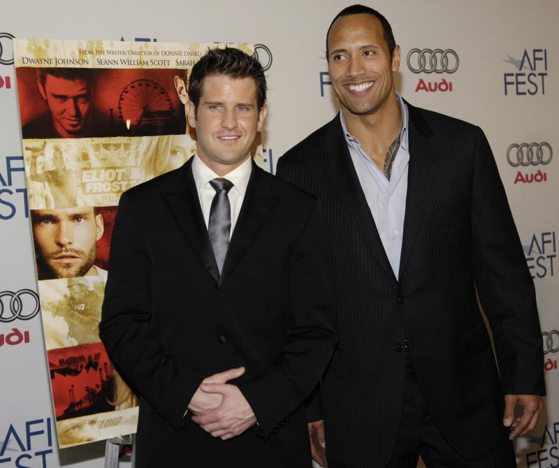 "Director Richard Kelly, left, poses with cast member Dwayne ""The Rock"" Johnson at the premiere of Southland Tales at the AFI Film Festival in Los Angeles, Friday, Nov. 2, 2007. (AP Photo/Chris Pizzello)"