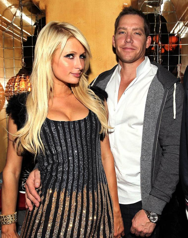 "Paris Hilton and her boy toy Cy Waits struck a pose at the Belvedere Vodka pre-Grammy party at Avalon in Hollywood on Thursday night. Christopher Polk/<a href=""http://www.gettyimages.com/"" target=""new"">GettyImages.com</a> - February 10, 2011"