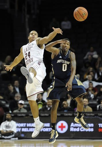 Saint Joseph's Chris Wilson (24) and Notre Dame's Eric Atkins (0) leap for a passed ball in the second half of the Coaches vs. Cancer Classic basketball game on Friday, Nov., 16, 2012, at Barclays Center in New York. (AP Photo/Kathy Kmonicek)