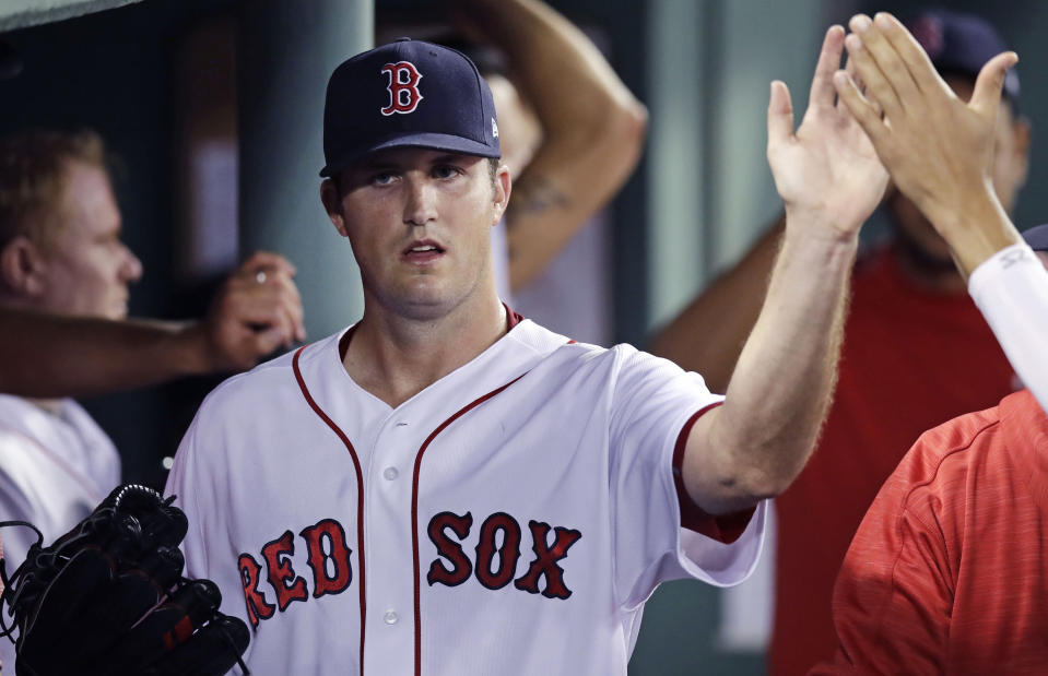 FILE - In this July 19, 2018, file photo, Boston Red Sox starting pitcher Drew Pomeranz is congratulated by teammates after being taken out of the game during the seventh inning after a three-hit outing at Fenway Park in Boston. The San Francisco Giants have had a quiet offseason, aside of course from acquiring new president of baseball operations Farhan Zaidi from the rival and six-time defending division champion Dodgers and challenging him with getting this proud franchise back into contention. Zaidi brought back left-hander Derek Holland for $7 million over one year. (AP Photo/Charles Krupa, File)