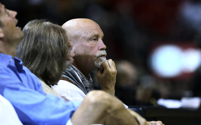 Actor John Malkovich watches game action during the first half of a NBA basketball game between the San Antonio Spurs and Miami Heat in Miami, Sunday, Jan. 26, 2014. (AP Photo/J Pat Carter)