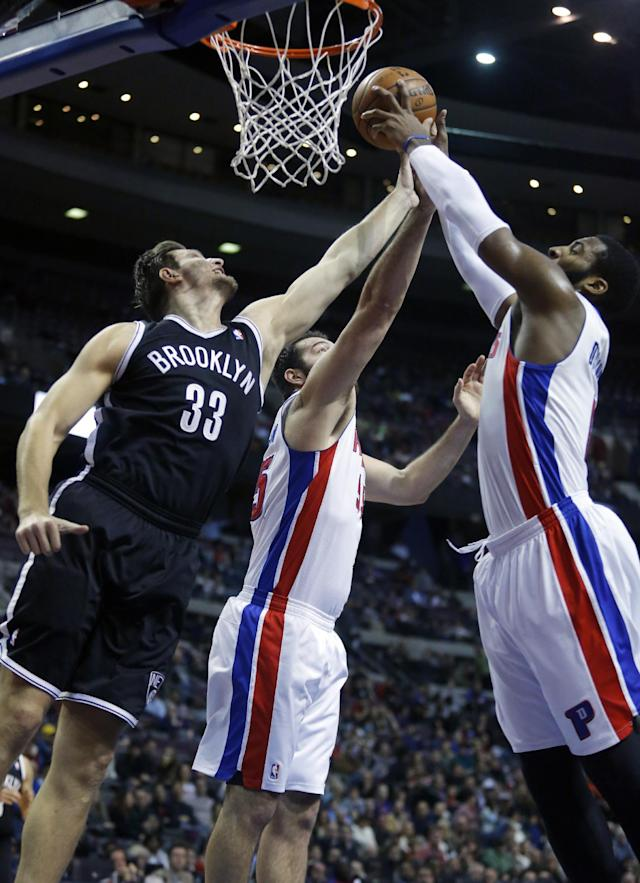 Brooklyn Nets forward Mirza Teletovic (33), Detroit Pistons forward Josh Harrellson (55) and center Andre Drummond (0) try to grab a rebound during the first half of an NBA basketball game on Friday, Dec. 13, 2013, in Auburn Hills, Mich. (AP Photo/Duane Burleson)