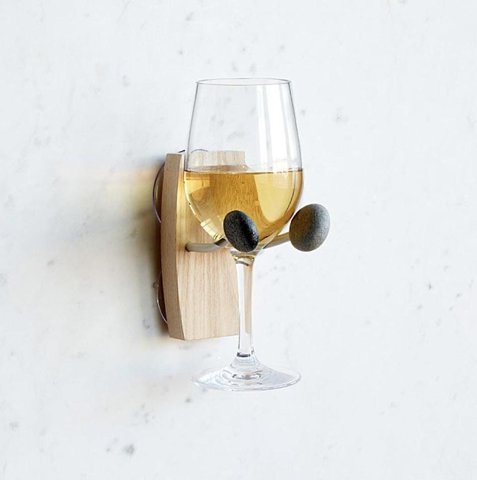 <p>This<span>Bathtime Essentials Wine Holder</span> ($38) will make them look forward to bath-time. It will easily stick to the tub wall and make space for their favorite vino.</p>