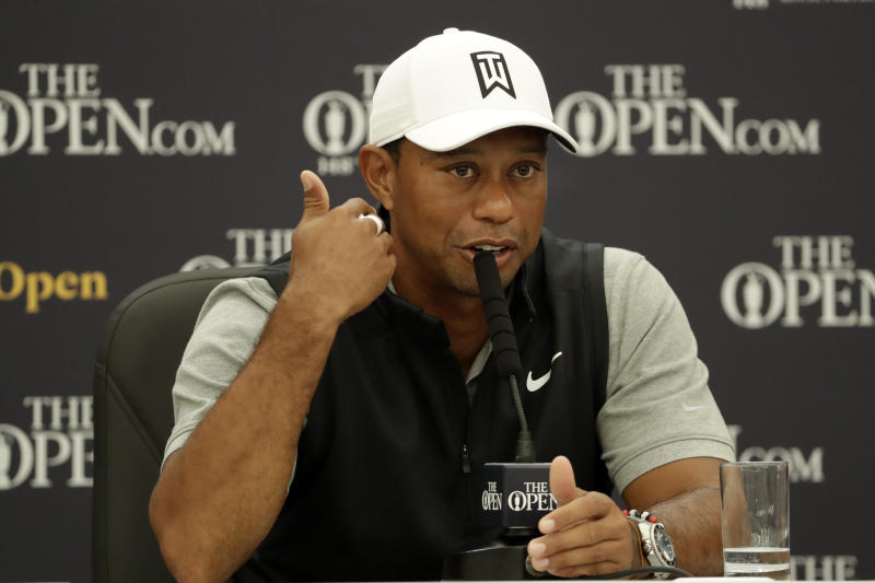 FILE - In this July 16, 2019, file photo, Tiger Woods speaks at a press conference ahead of the start of the British Open golf championships at Royal Portrush in Northern Ireland. Woods responded to the protests and some of the violence around the country by saying points can be made without destroying property. (AP Photo/Matt Dunham, File)