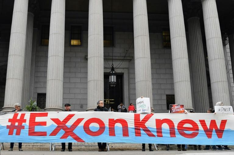 Climate activists protest on the first day of the ExxonMobil trial outside the New York State Supreme Court building (AFP Photo/Angela Weiss)