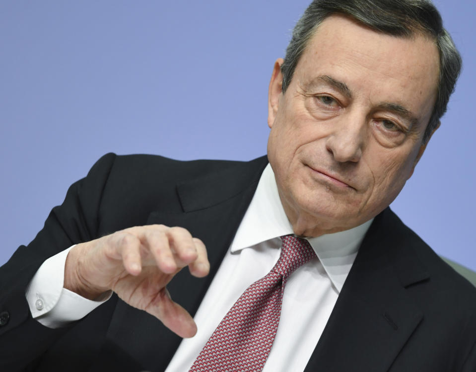 President of European Central Bank Mario Draghi talks to the media during a press conference following the meeting of the ECB governing council in Frankfurt, Germany,Thursday, Jan.24, 2019. (Arne Dedert/dpa via AP)