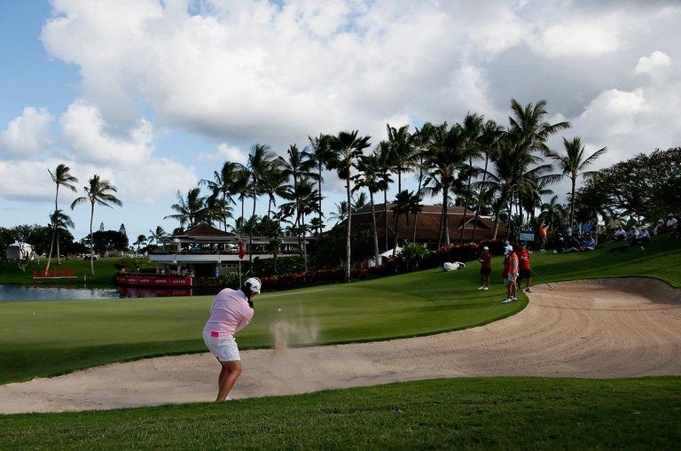 Ariya Jutanugarn of Thailand hits out of the sand on the 18th hole on April 17, 2013 in Kapolei, Hawaii