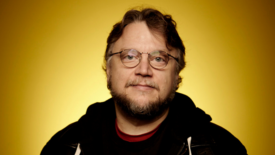 Writer, director, producer Guillermo Del Toro against a bright yello backdrop for Cabinet of Curiosities