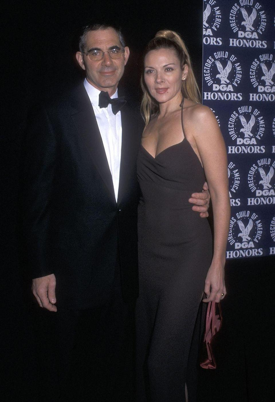 """<p>In 2002, Kim and her then-husband Mark cowrote a book about sex titled <em><a href=""""https://www.amazon.com/Satisfaction-Female-Orgasm-Kim-Cattrall/dp/0446530719/"""" rel=""""nofollow noopener"""" target=""""_blank"""" data-ylk=""""slk:Satisfaction: The Art of the Female Orgasm"""" class=""""link rapid-noclick-resp"""">Satisfaction: The Art of the Female Orgasm</a></em>. Despite their shared passion project, the actress and the audio designer/jazz bassist ended their six-year marriage in 2004, partially because of Kim's demanding <em>Sex and the City</em> work schedule. """"It cost me my marriage, because I was never home,"""" she told <a href=""""https://www.news.com.au/lifestyle/relationships/marriage/kim-cattrall-opens-up-about-how-satc-took-over-her-real-life-family/news-story/b386bb7556125ff38d861428a11a4acb"""" rel=""""nofollow noopener"""" target=""""_blank"""" data-ylk=""""slk:News.com.au"""" class=""""link rapid-noclick-resp"""">News.com.au</a> of the show. """"I was never there, and my husband got lonely and upset and competitive, and it was really difficult, it was really hard.""""</p>"""