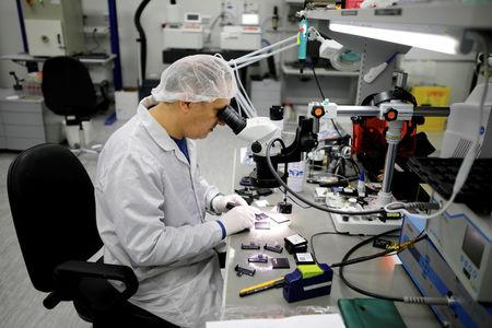 FILE PHOTO: A technician works in a cleanroom at Mellanox Technologies building in Yokneam, Israel