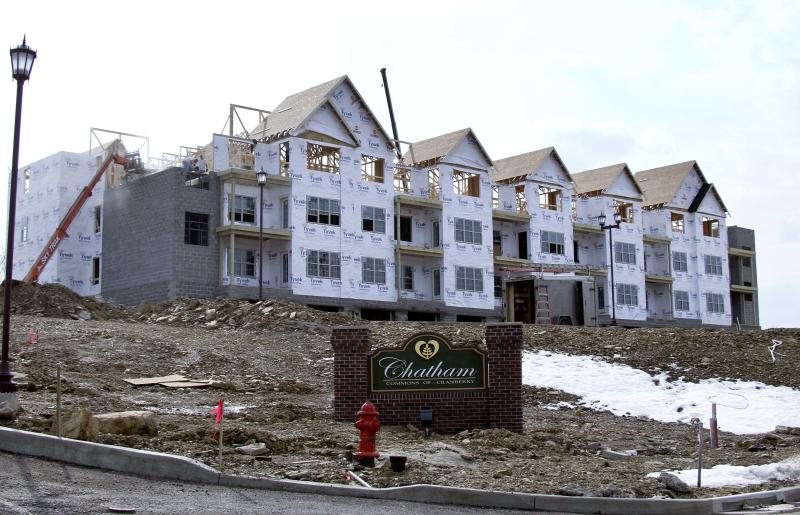 In this photo made Feb. 17, 2011, construction continues on a row of condominiums in Cranberry, Pa., Butler County. Sales of new homes plunge to record low Wednesday, March 23, 2011, a dismal sign for an already-weak housing market.(AP Photo/Keith Srakocic)