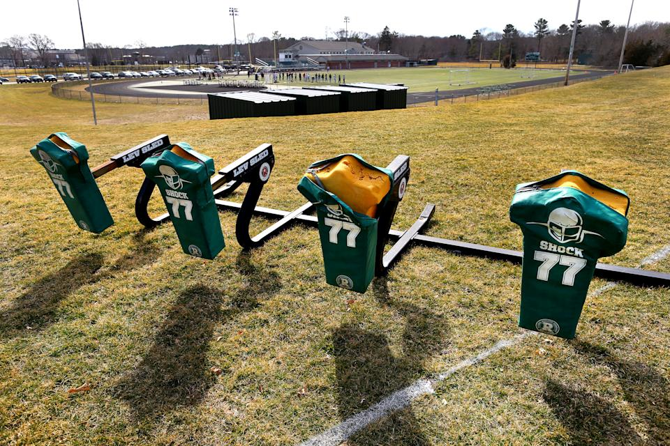 DUXBURY - MARCH 24: Duxbury High School football's practice sleds sit idle next to the football field, after football games were cancelled and Duxbury High School fired their football coach, Dave Maimaron, in Duxbury, MA, on March 24, 2021. The Town of Duxbury is in the limelight after Duxbury High School fired their football coach, Dave Maimaron after his team used anti-Semetic terms in a recent game. (Photo by John Tlumacki/The Boston Globe via Getty Images)
