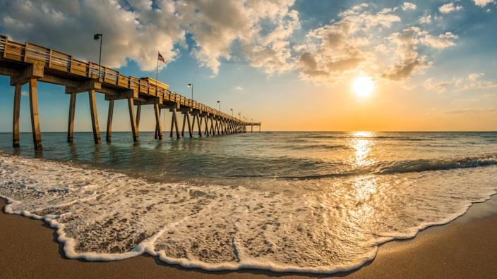 late afternoon sun over Gulf of Mexico and Venice Pier in Venice Florida - Image.