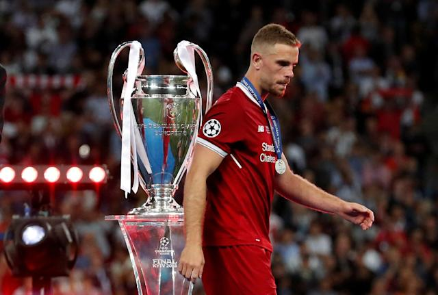 Soccer Football - Champions League Final - Real Madrid v Liverpool - NSC Olympic Stadium, Kiev, Ukraine - May 26, 2018 Liverpool's Jordan Henderson looks dejected as he walks past the Champions League trophy during the medal ceremony after the match REUTERS/Andrew Boyers TPX IMAGES OF THE DAY