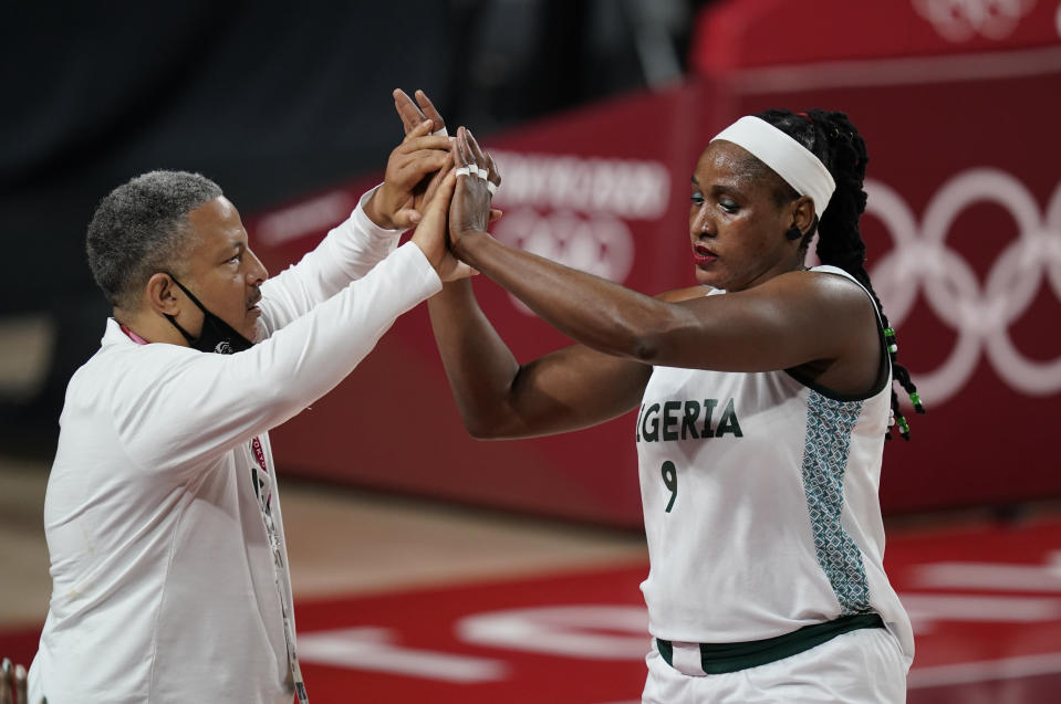 Nigeria's Aisha Mohammed (9) high five with head coach Otis Hughley Jr as she exits the game during women's basketball preliminary round game at the 2020 Summer Olympics, Monday, Aug. 2, 2021, in Saitama, Japan. (AP Photo/Charlie Neibergall)