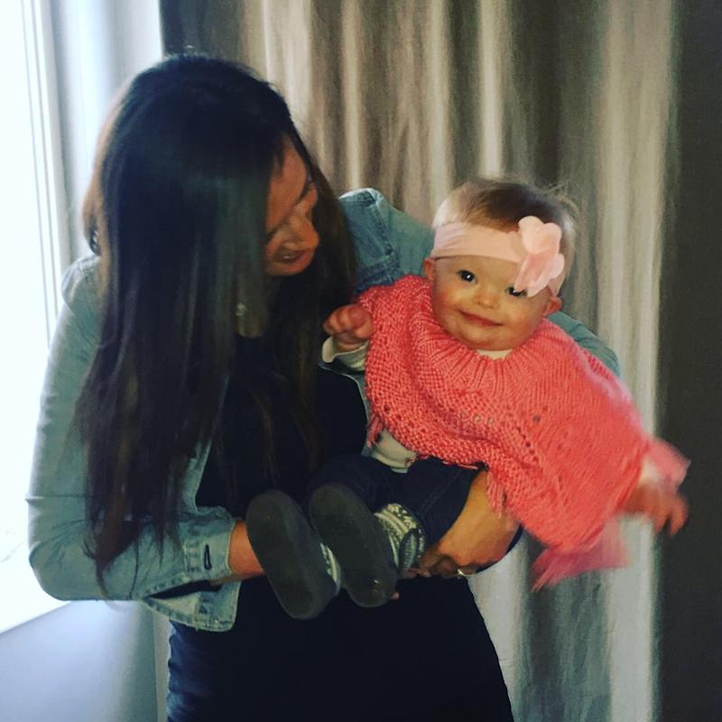 Ann with her toddler daughter who has Down syndrome