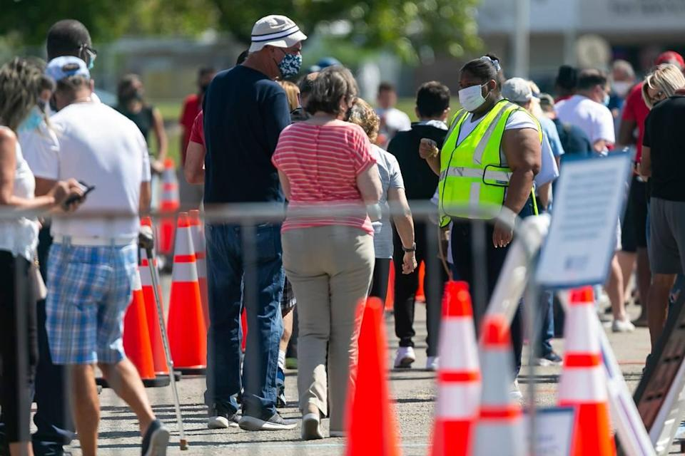 People line up to receive a COVID-19 vaccine at the Miami Dade College North vaccination site in Miami, Florida on Sunday, March 7, 2021.