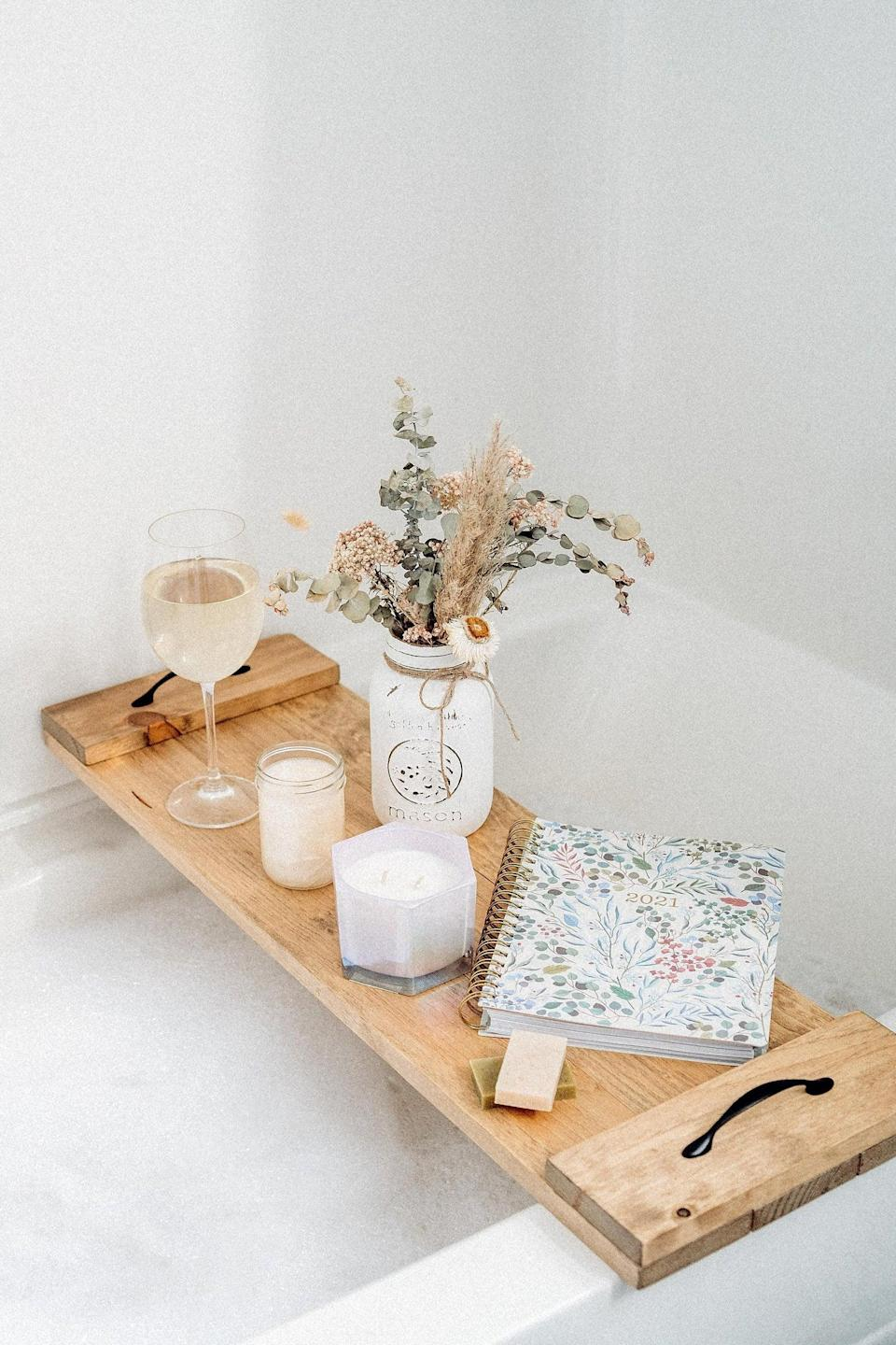 <p>She can take her bath time to the next level with this fun-filled <span>Bathtub Caddy</span> ($73 and up). She can grab a glass of wine, a notebook, or her latest read and prepare to unwind after work.</p>