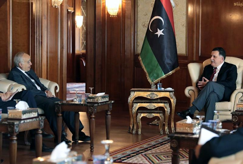 A handout picture provided by the press office of Libyan Prime Minister Fayez al-Sarraj shows him (R) meeting with New UN envoy Ghassan Salame (L) on August 5, 2017 in the capital Tripoli