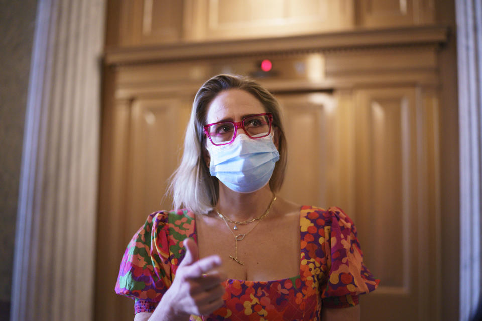"""Sen. Kyrsten Sinema, D-Ariz., a centrist Democratic senator vital to the fate of President Joe Biden's $3.5 trillion """"Build Back Better"""" agenda, departs the Senate before meeting with Biden at the White House, at the Capitol in Washington, Tuesday, Sept. 28, 2021. Sinema and fellow moderate, Sen. Joe Manchin, D-W.Va., have balked at the price tag and are now under pressure to show Biden what size package they could live with. (AP Photo/J. Scott Applewhite)"""