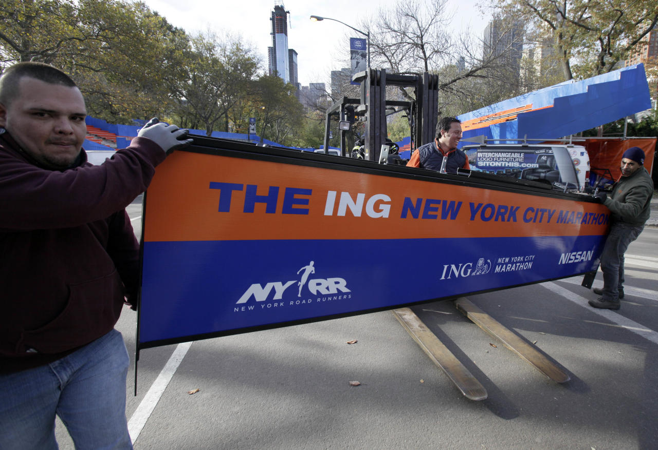 Workers assemble the finish line for the New York City Marathon in New York's Central Park, Thursday, Nov. 1, 2012. The 43rd New York City Marathon is on Sunday, with many logistical questions to be answered. The crane atop a high rise that collapsed during superstorm Sandy is visible at background center.(AP Photo/Richard Drew)Workers assemble the finish line for the New York City Marathon in New York's Central Park, Thursday, Nov. 1, 2012. The New York City Marathon is on Sunday, with many logistical questions to be answered. (AP Photo/Richard Drew)
