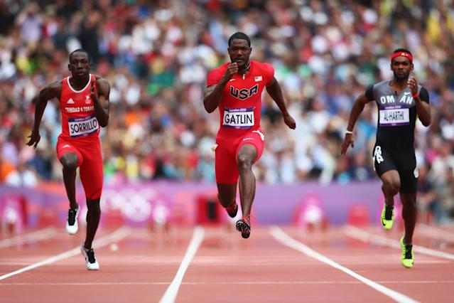 LONDON, ENGLAND - AUGUST 04: (L-R) Rondel Sorrillo of Trinidad and Tobago, Justin Gatlin of the United States and Barakat Mubarak Al-Harthi of Oman compete in the Men's 100m Round 1 Heats on Day 8 of the London 2012 Olympic Games at Olympic Stadium on August 4, 2012 in London, England. (Photo by Michael Steele/Getty Images)