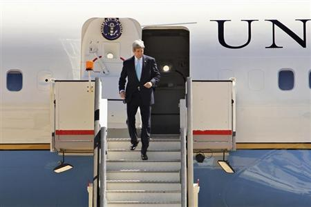 U.S. Secretary of State John Kerry leaves his plane as he arrives in Amman