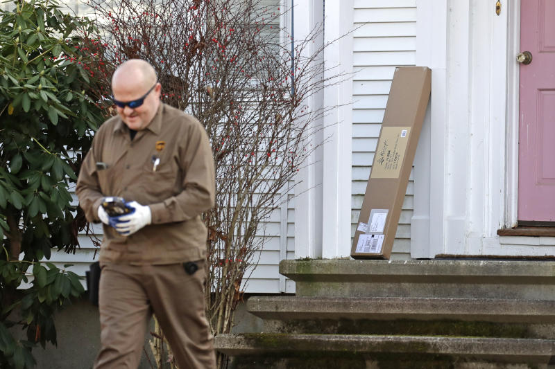 "In this Nov. 26, 2019, photo a UPS man delivers a package to a residence in North Andover, Mass.  ""Cyber Monday"" is still holding up as the biggest online shopping day of the year, even though the same deals have been available online for weeks and the name harks back to the days of dial-up modems. (AP Photo/Elise Amendola)"
