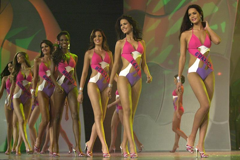 FILE - In this Sept. 23, 2004 file photo, Monica Spear, far right, competes in the swim suite competition before winning the Miss Venezuela beauty pageant in Caracas, Venezuela. Venezuelan authorities say the soap-opera actress and former Miss Venezuela and her husband were shot and killed resisting a robbery after their car broke down. Prosecutors said in a statement that Monica Spear and Henry Thomas Berry were slain late Monday, Jan. 6, 2014 near Puerto Cabello, Venezuela's main port. (AP Photo/Leslie Mazoch, File)