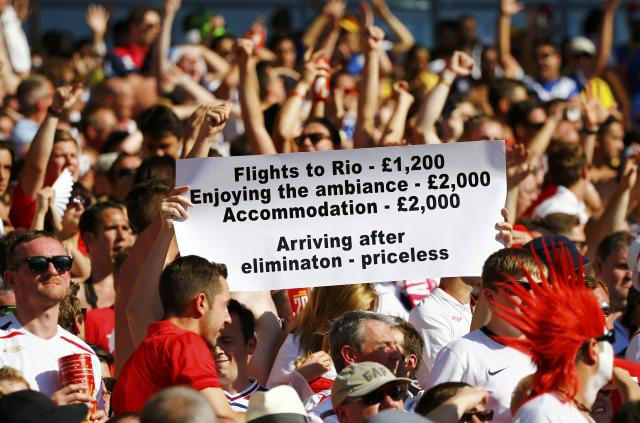 Fans of England hold up a sign during their 2014 World Cup Group D soccer match against Costa Rica at the Mineirao stadium in Belo Horizonte