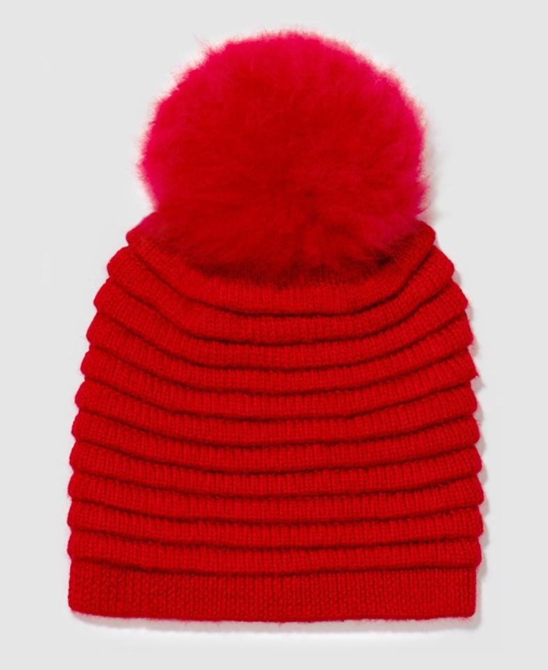 "Stay warm and give back with Meghan Markle's go-to coat brand Sentaler. The Canadian label's baby alpaca Ribbed Hat comes complete with an oversized fur pompon, and proceeds of all sales go to the Sick Kids Foundation, helping pediatric patients worldwide.  <strong>Buy it!</strong> Adult Ribbed Hat with Oversized Fur Pompon, $195; <a href=""https://sentaler.com/products/adult-ribbed-hat-with-oversized-fur-pompon-red"" target=""_blank"" rel=""nofollow"">sentaler.com</a>"