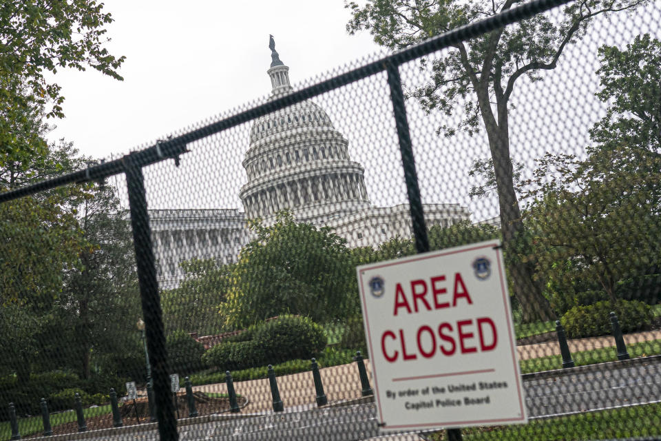 """A security fence borders the U.S. Capitol ahead of a rally in Washington, Saturday, Sept. 18, 2021. The rally was planned by allies of former President Donald Trump and aimed at supporting the so-called """"political prisoners"""" of the Jan. 6 insurrection at the U.S. Capitol. (AP Photo/Nathan Howard)"""