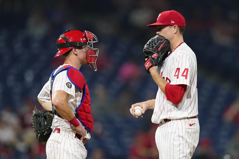 Philadelphia Phillies pitcher Kyle Gibson, right, and catcher Andrew Knapp talk during the fifth inning of a baseball game against the Chicago Cubs, Tuesday, Sept. 14, 2021, in Philadelphia. (AP Photo/Matt Slocum)